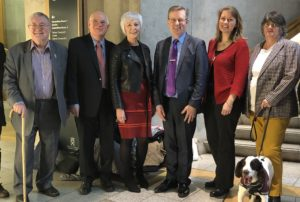 Sally Shaw with Alexander Stewart MSP, Janis Macdonald of deafscotland and other hearing access supporters