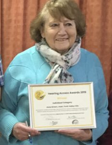 A woman with a framed certificate