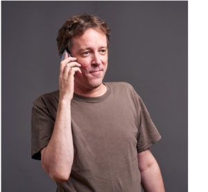 A middle age man makes a phone call