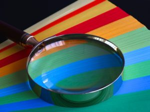 A colourful picture of a magnifying glass